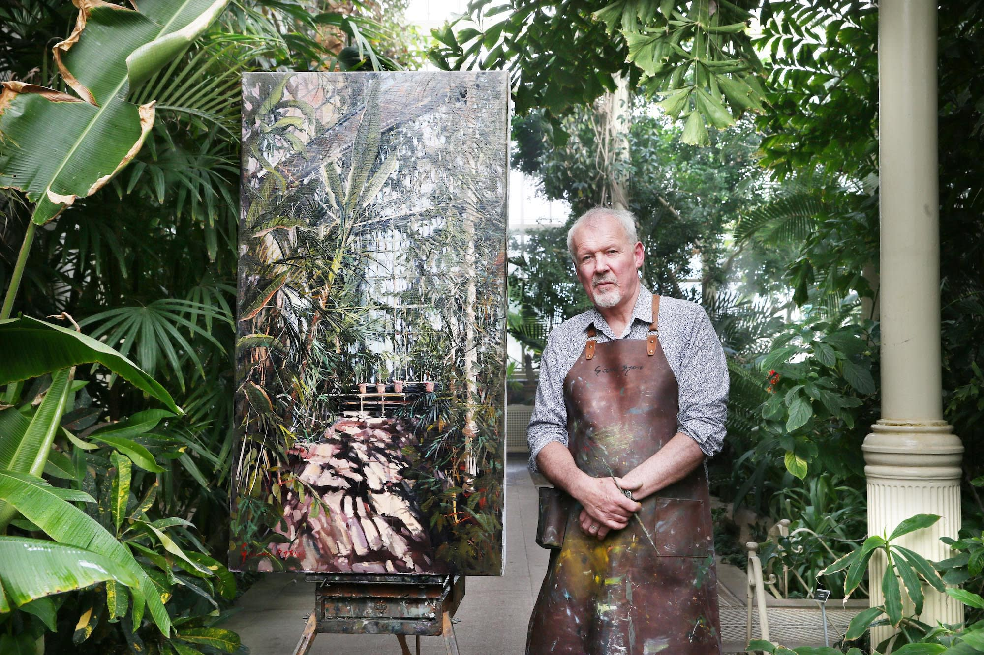 Gerard Byrne with his painting 'Tropical House' at The Palm House, National Botanic Gardens of Ireland, Dublin. photo credit Leon Farrell