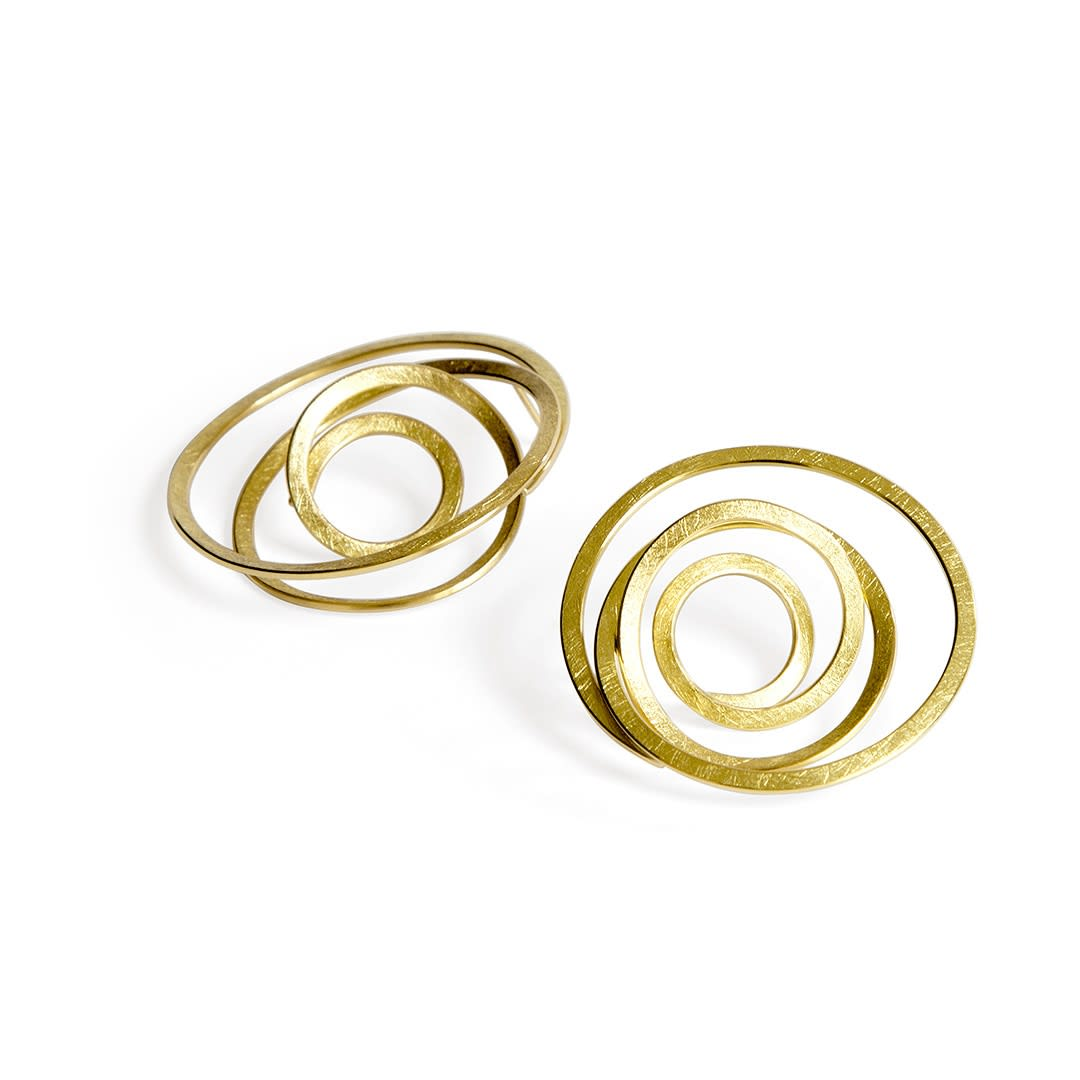 Fairtrade Gold infinity spiral earrings by jeweller ute decker
