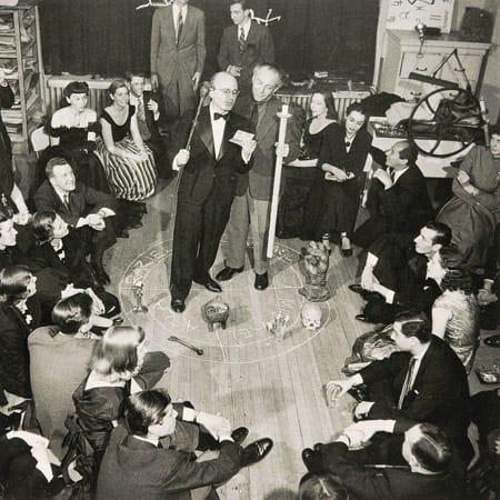 "Photograph of a ""Magic Evening"" (""Soirée Seligmann"") in Kurt Seligmann's New York studio, 1948. Kurt Seligmann and Enrico Donati in a magic circle. Photograph by Bernard Hoffman."