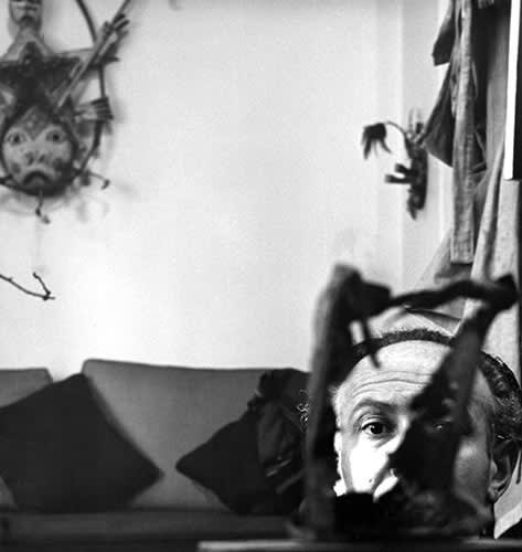 Enrico Donati with Yup'ik mask, c. 1948