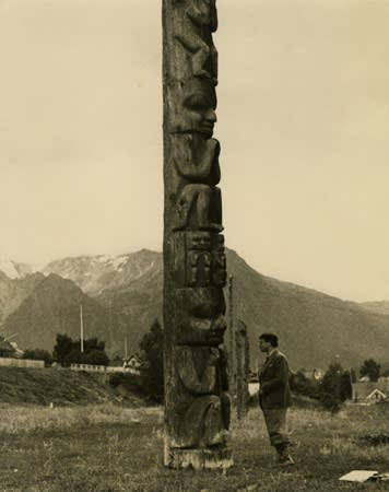 Kurt Seligmann in front of a Gitksan Totem Pole, British Columbia, 1938.