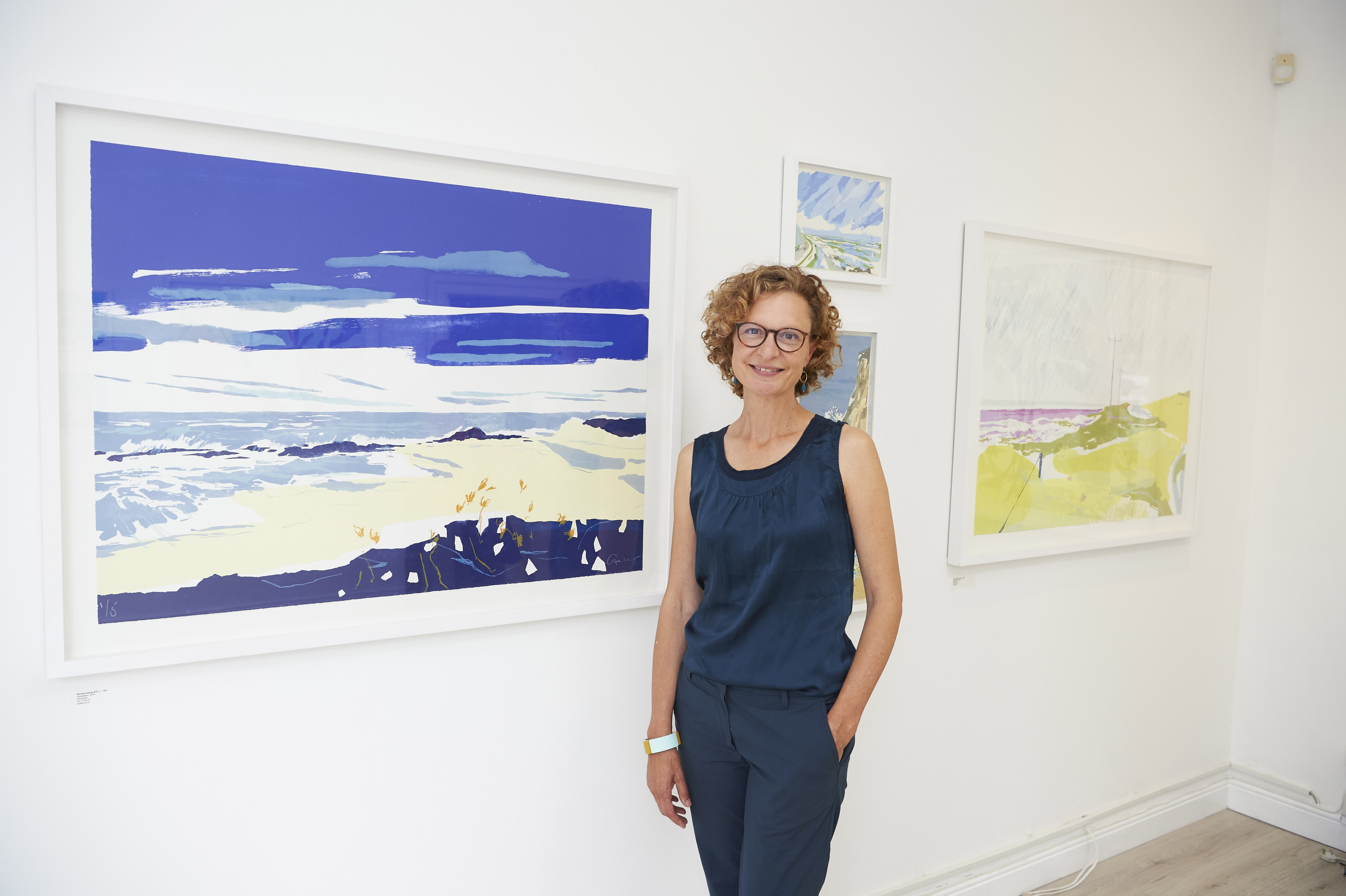 Rachel Gracey in front of her exhibition series 'The Pacific Coast'