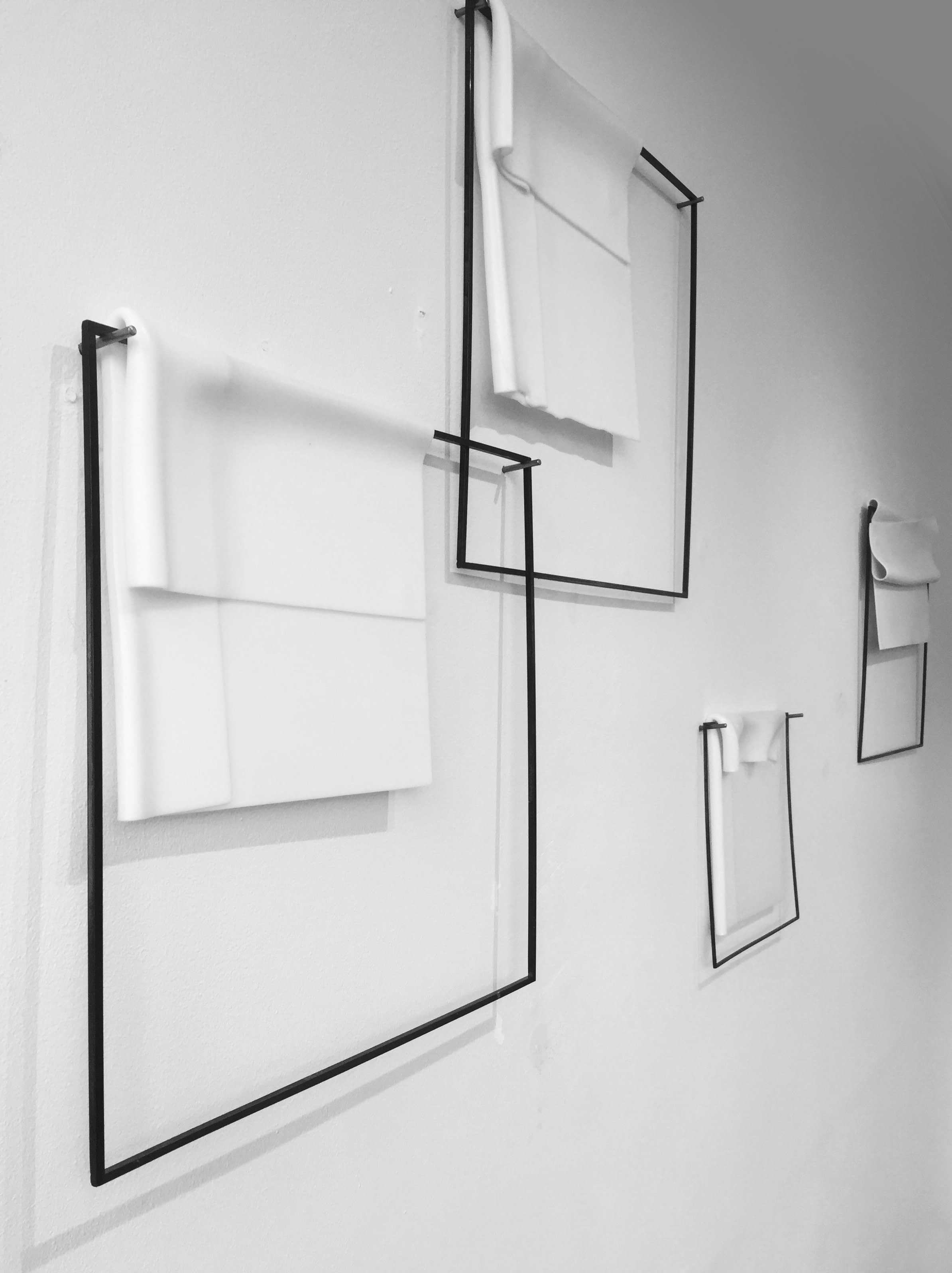 Marzena Krzemińska-Baluch, installed view of The Stijl/The Style series, 2017, kilnformed glass and metal frames.