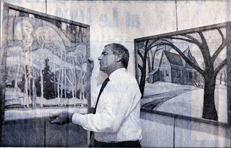 Eric Klinkhoff holds Anne Savage painting