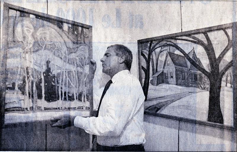 Eric Klinkhoff holds Anne Savage painting