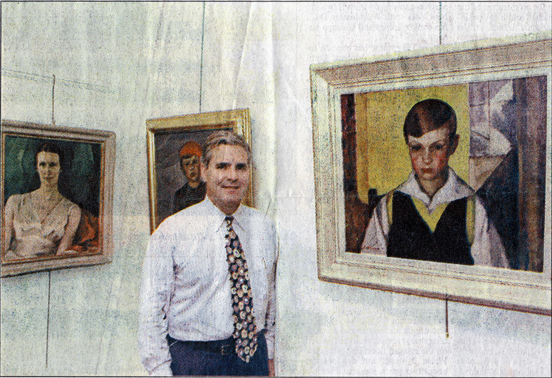 Eric Klinkhoff with portraits by Lilias Torrance Newton. (Gazette Photo)