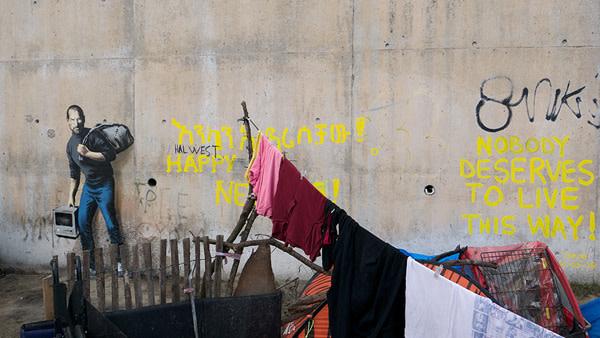 Banksy's Artwork Of Steve Jobs Defaced In Calais Refugee