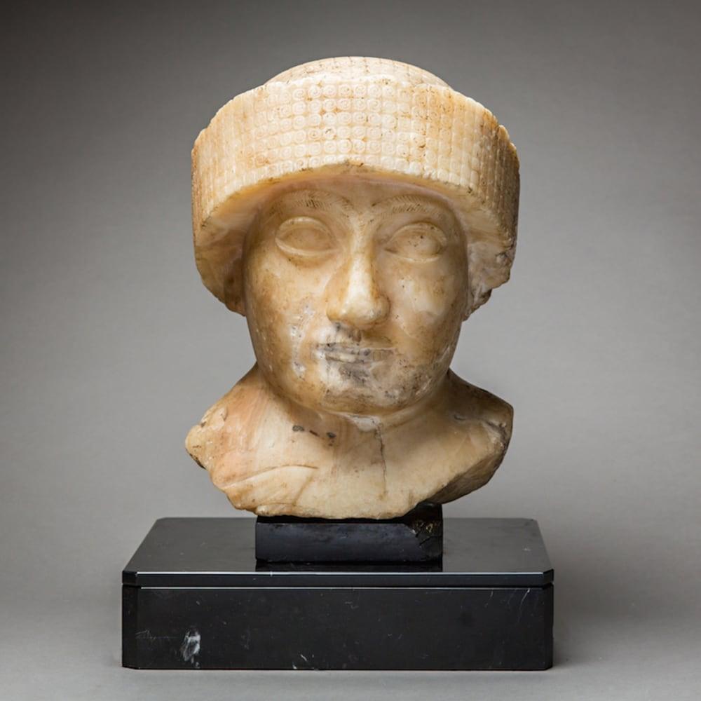 Neo-Sumerian Alabaster Bust of Gudea, 2200 BCE - 2100 BCE  Alabaster  9.5 x 12.5