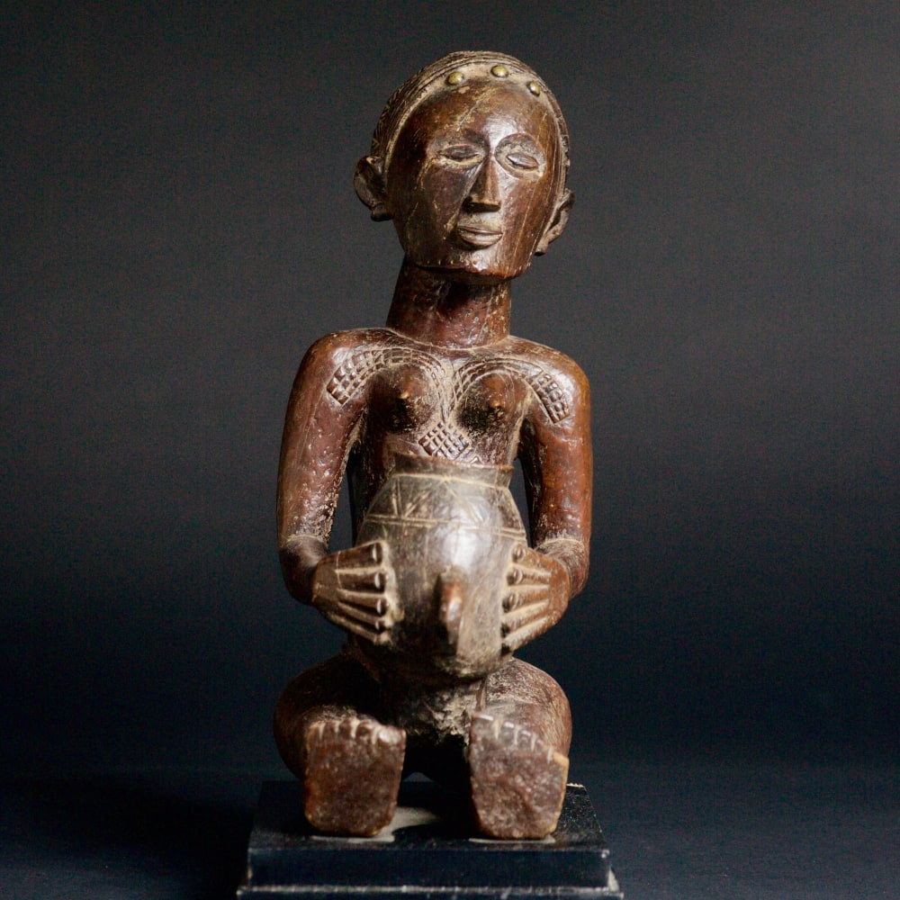 Luba Figure of a Woman, 19th - 20th century  Wood  height 37 cm  height 14 5/8 in