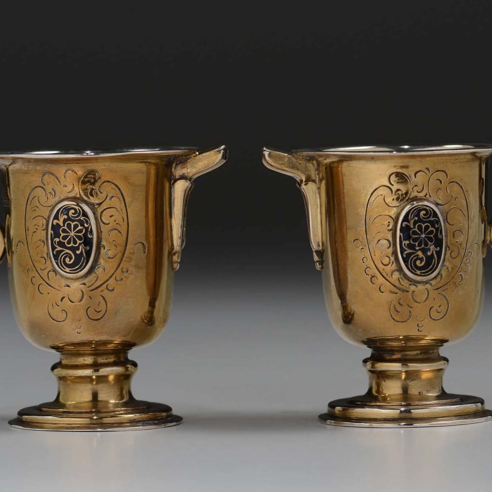Pair of small jugs, acqua and vinum, in gilt silver and enamels, Spain, 16th century