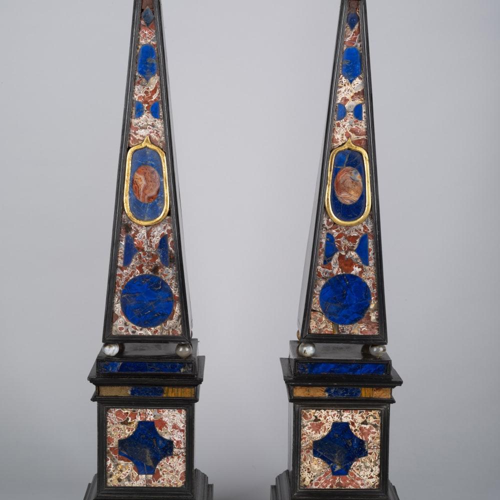 Pair of Pietra Dura Obelisks Rome, Second quarter of the 17th Century Jasper, agate, lapis lazuli, ebonized wood, gilt metal 64.5 x 14.5 x 12 cm