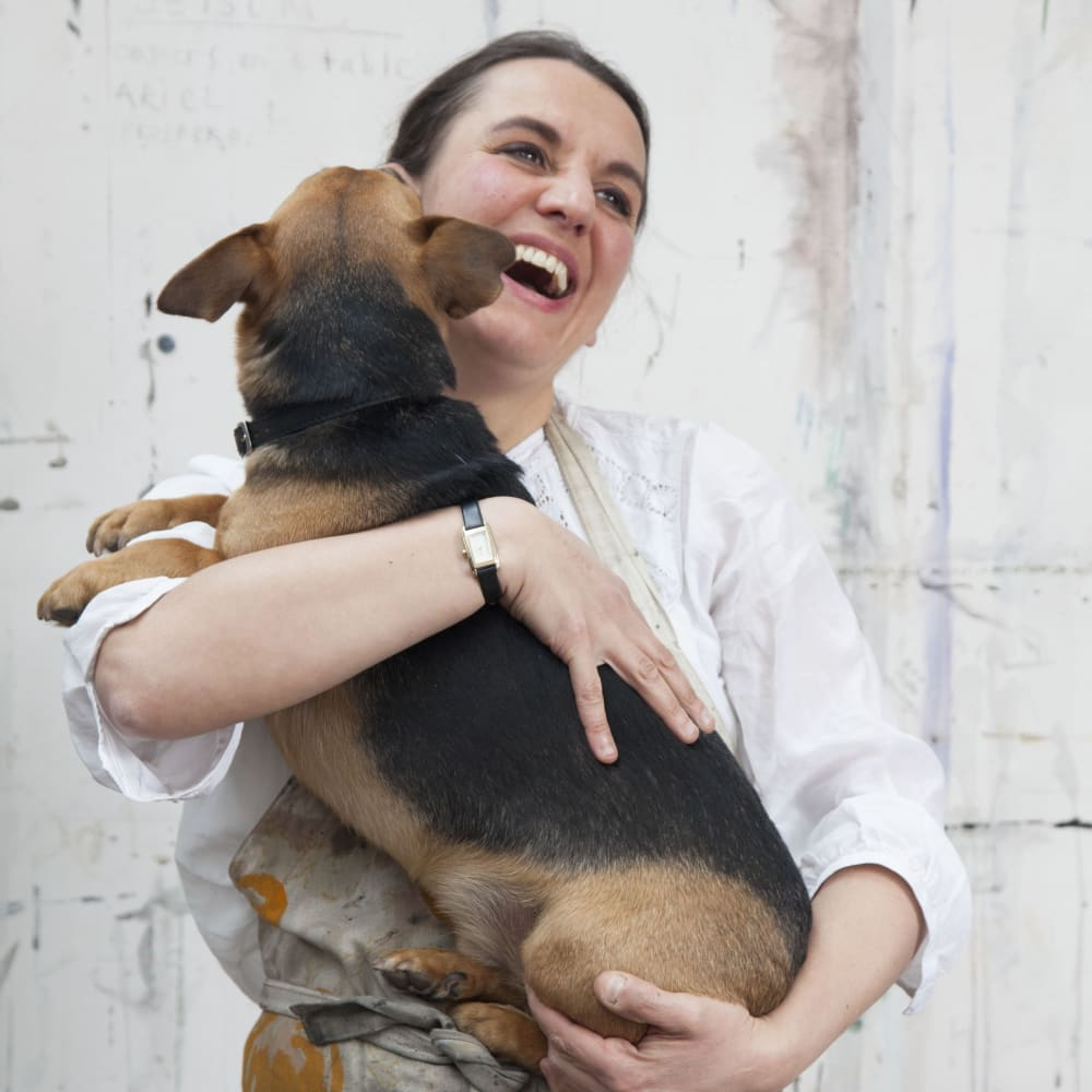 Sophie Charalambous with Theo, her studio companion.