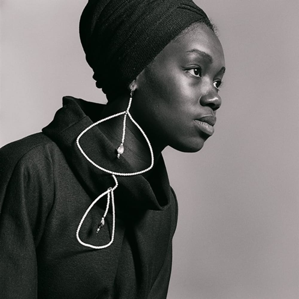 Kwame Brathwaite, Untitled (Nomsa Brath with earrings designed by Carolee Prince) (1964). Archival pigment print. Courtesy of the artist and Philip Martin Gallery, Los Angeles.