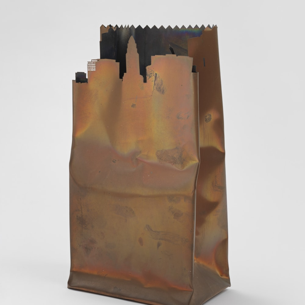 Jerry McMillan, Untilted (L.A. Bag) (1977). Photo etched .007 copper bag construction on Plexiglas base, 11 1/4 x 6 1/2 x 4 inches. Courtesy of the artist and Hauser & Wirth, New York. Photo: Genevieve Hanson.