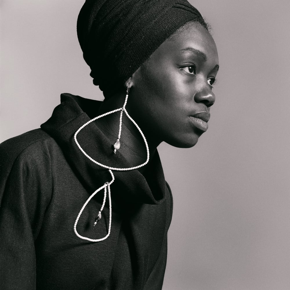 Untitled (Nomsa Brath with earrings designed by Carolee Prince), 1964. Credit Kwame Brathwaite/Courtesy of Philip Martin Gallery, Los Angeles