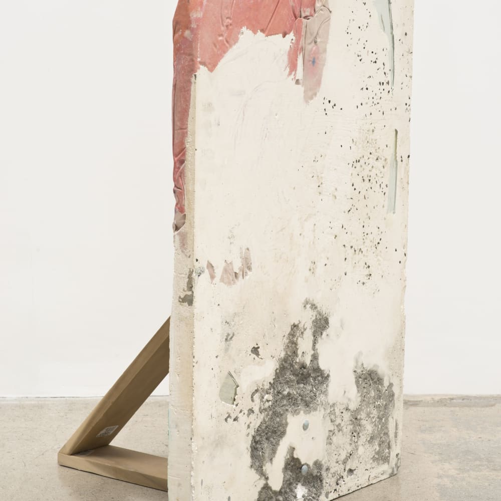 "Katy Cowan, ""Trace"" (2013). Plaster, sun-sensitive paint on fabric, poplar, fabric dye, mirror shards, 44 x 24 x 18 inches."