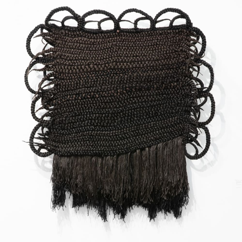 """Joanne Petit-Frère, """"Tapestry of Braids #1 (Woven while Discovering bell hooks on YouTube),"""" (2020). Synthetic hair, thread, wire, 54 x..."""
