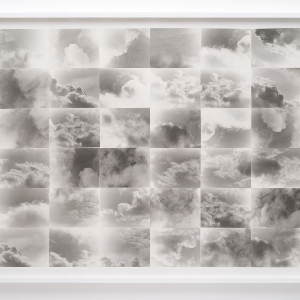 """Lew Thomas, """"CLOUDS"""" (1973/2015). 36 gelatin silver prints, mounted and framed, 52 x 64 inches."""