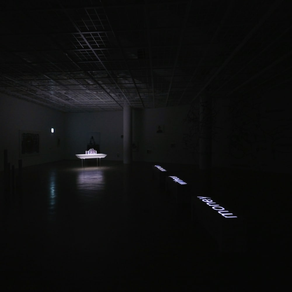 Installation view of Equation = TIME and/of Evolution in City, at the exhibition'Money Without Nationality' Art Sonje Center, 2017, [the exhibition space under dark condition] https://vimeo.com/247592715