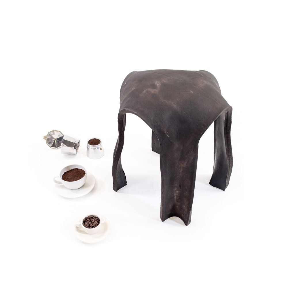 Kristen Wang Re. Bean Coffee Stool used coffee ground waste (from local café), disposed hessian coffee bean bag (from coffee roasting factory) natural, biodegradable binding (from organic waste) 19 3/4 x 15 3/4 x 15 3/4 in 50 x 40 x 40 cm