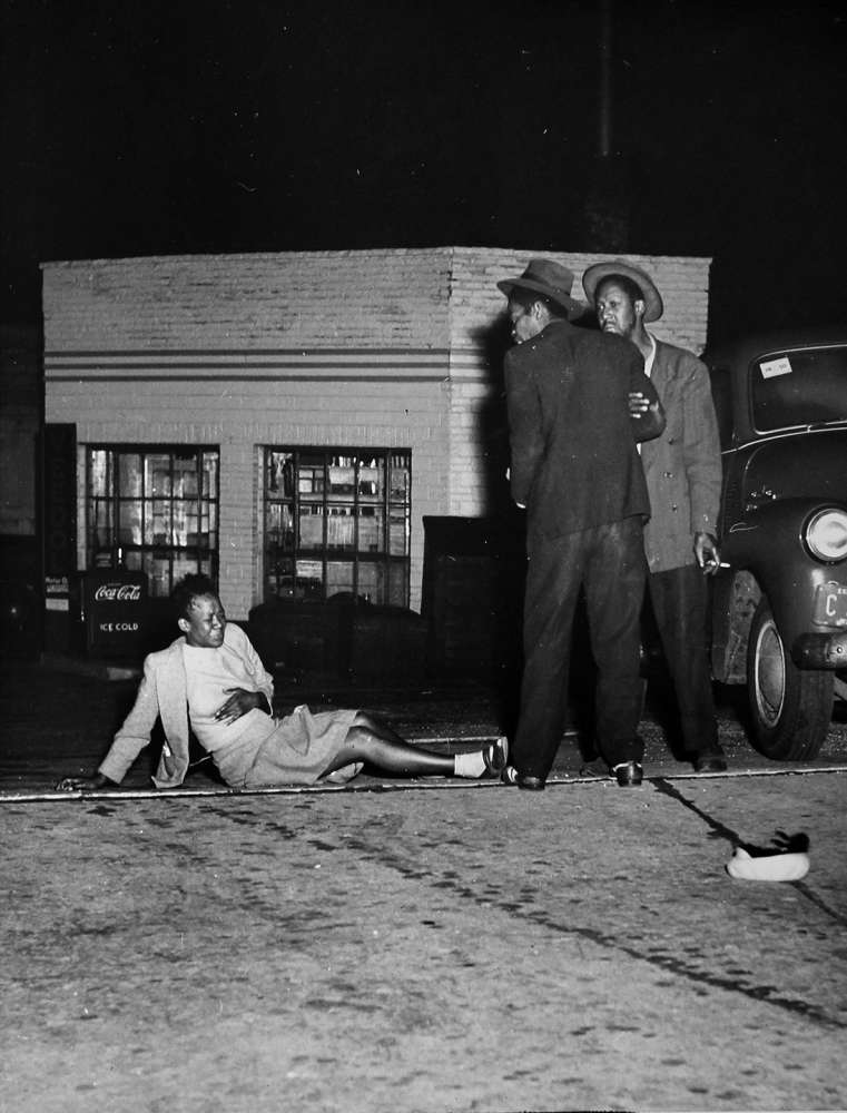 Weegee, Milwaukee (Woman knocked over in a brawl), 1948