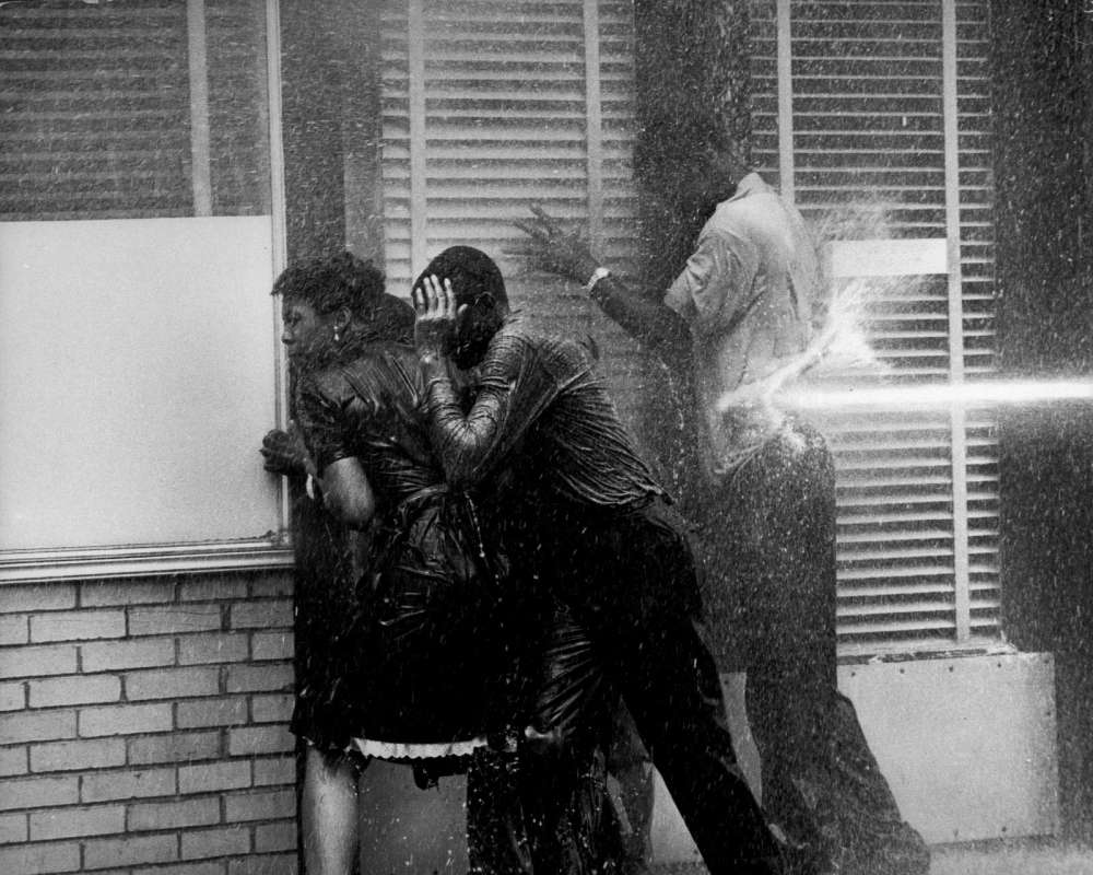 Charles Moore, Three People in Doorway Being Fire Hosed, Birmingham, AL, 1963