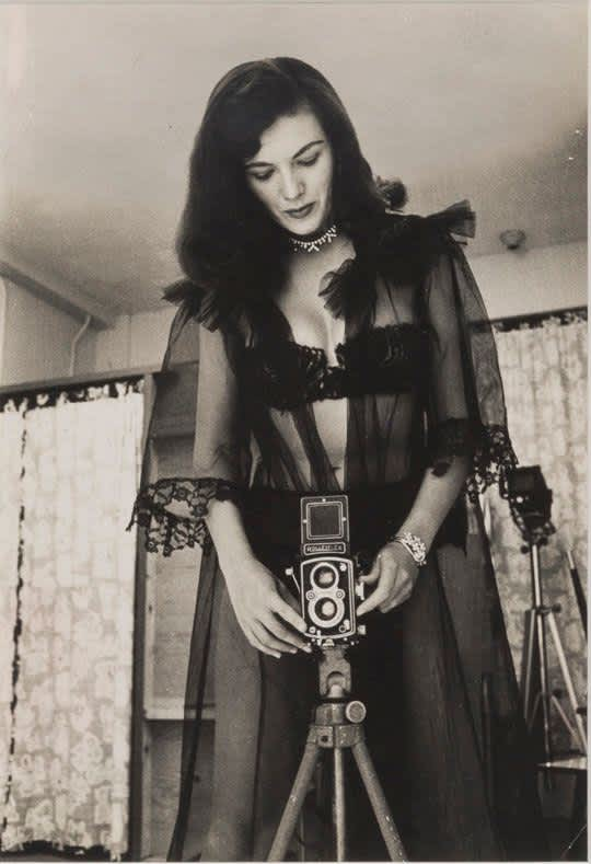 Bunny Yeager, Bunny Yeager in Black Lace with Her Rolleiflex Camera, 1955
