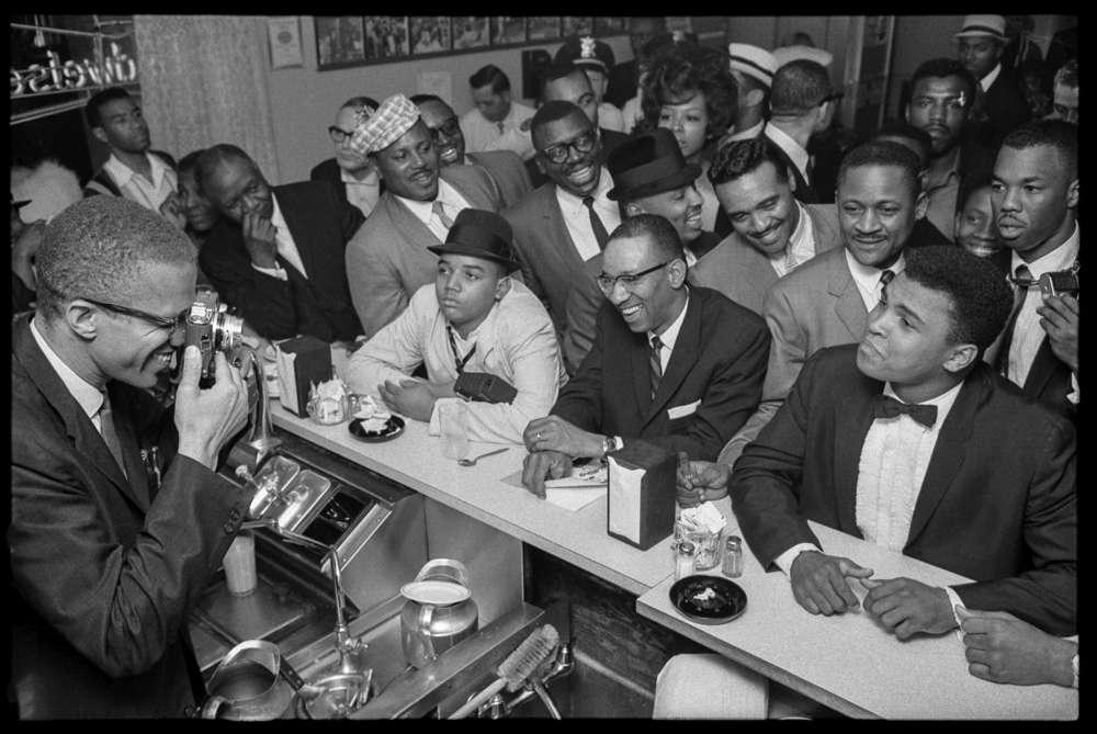 Bob Gomel, Black Muslim leader Malcolm X photographing Cassius Clay, Miami, 1964