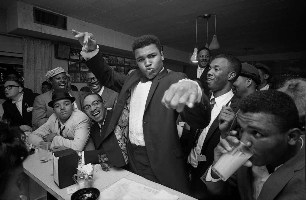 Bob Gomel, Cassius Clay (Muhammad Ali) victory party after he defeated Sonny Liston for the Heavyweight Championship, February, 1964