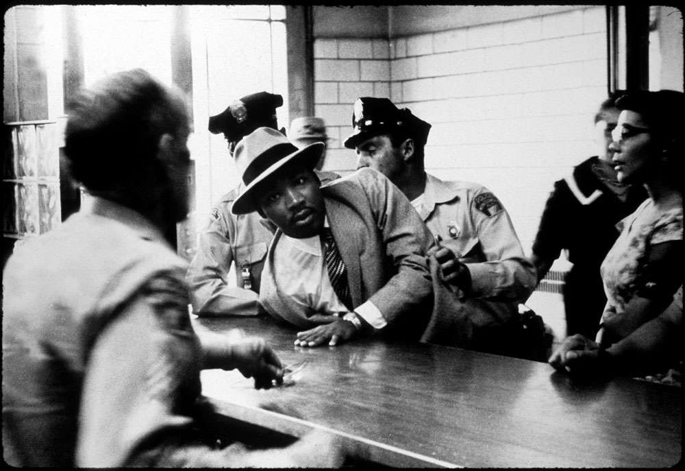 Charles Moore, Arrest of Martin Luther King Jr. at Police Department, Montgomery, AL, 1958