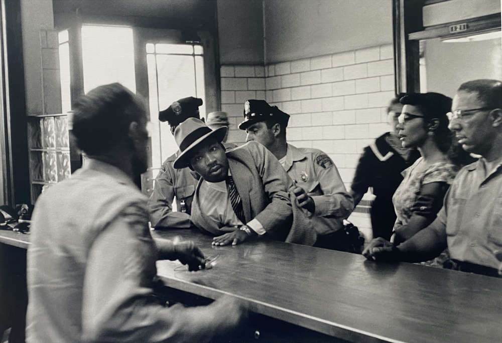 Charles Moore, Arrest of Martin Luther King Jr. at Police Department, Montgomery, Alabama, 1958
