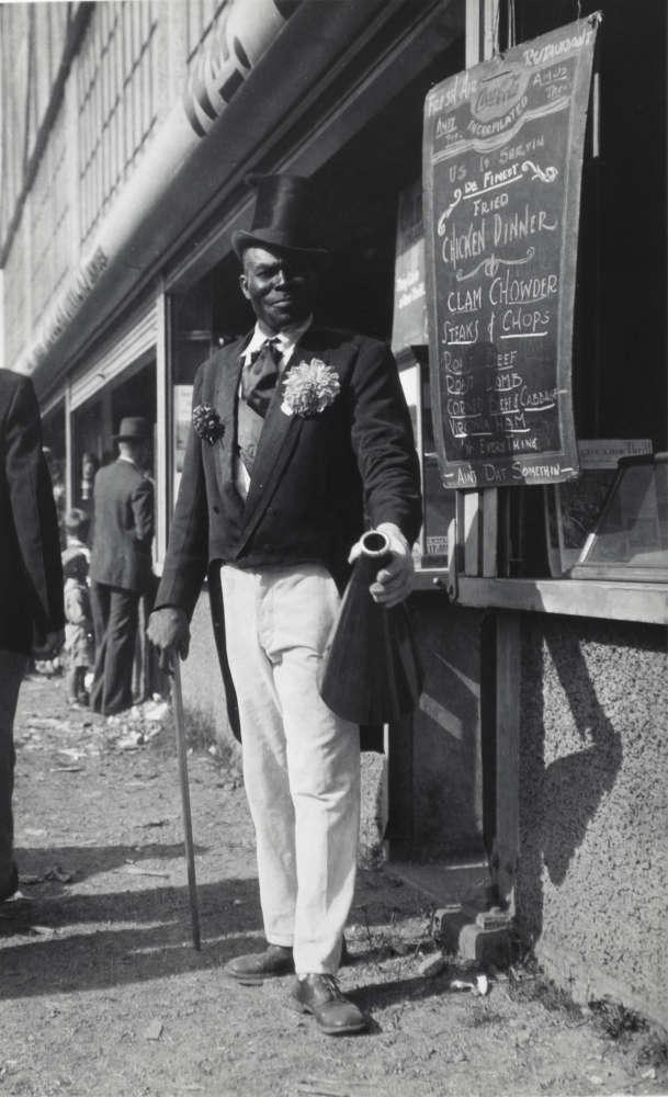 Walker Evans, Barker with Megaphone Outside Food Stand, New York City, 1928-29