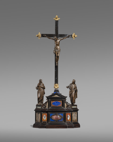 """<div class=""""artist""""><strong>Pietro Tacca and workshop</strong></div><div class=""""title_and_year""""><em>The Crucifixion with the Virgin Mary and Saint John the Evangelist</em>, <span class=""""title_and_year_year"""">late 16th–early 17th century</span></div><div class=""""medium"""">Bronze, on an ebonised wood base, mounted with plaques of pietre dure, gilt bronze finials</div><div class=""""dimensions"""">123 x 51 x 21 cm (48 3/8 x 20 1/8 x 8 1/4 in.)<br/> </div>"""
