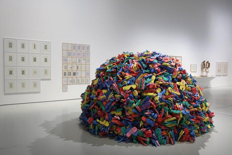 "<span class=""title"">Hassan Sharif: I am The Single Work Artist<span class=""title_comma"">, </span></span><span class=""year"">2021</span>"