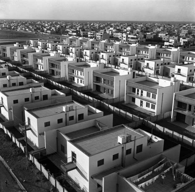 "<div class=""title""><em>Housing project office, Yarmouk, Baghdad, 1962</em>, 2019</div><div class=""medium"">Inkjet print on Hahnemuhle fine art photo rag pearl 320 gsm paper</div><div class=""dimensions"">100 x 100 cm</div><div class=""edition_details"">Edition of 3 (+2 AP)</div><div class=""edition_details""><p class=""p1""><br class=""Apple-interchange-newline"" />Latif Al Ani Collection, courtesy of the Arab Image Foundation and Gallery Isabelle van den Eynde, Dubai. </p></div>"