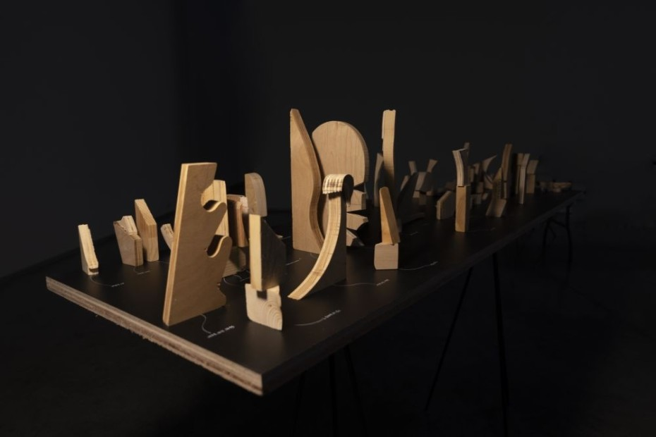 <p><strong>Vikram Divecha</strong></p><p><em>The relationship between wood and sunlight</em>, 2018<br />Scrap pieces from Columbia University woodshop, white marker, laminated plywood, metal frame, Ikea floor lamp<br />Variable dimensions</p>