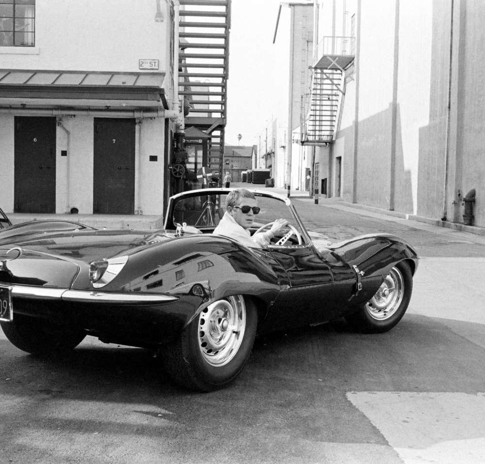 John Dominis - Steve McQueen in black jaguar at studio, CA