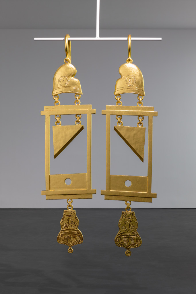 A Dramatically Enlarged Set of Golden Guillotine Earrings Depicting the Severed Heads of Marie Antoinette and King Louis XVI