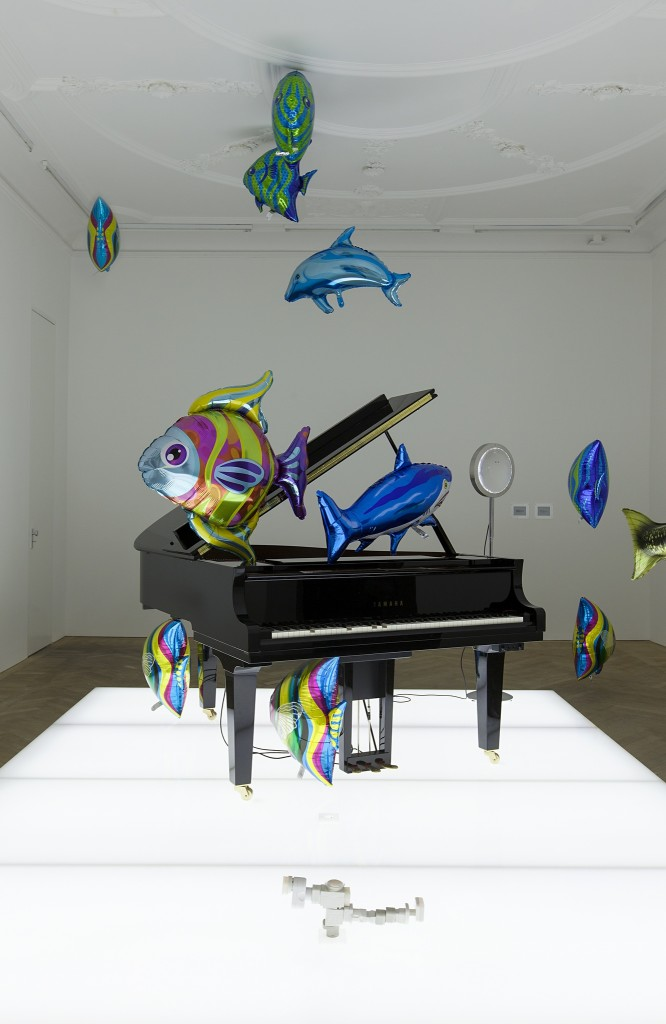 Quasi Objects: My Room is a Fish Bowl, AC/DC Snakes, Happy Ending, Il Tempo del Postino, Opalescent acrylic glass podium, Disklavier Piano