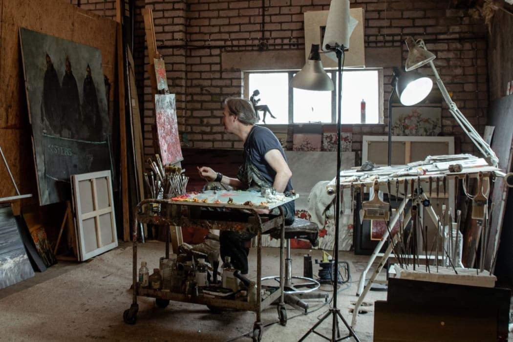 Artist Gordon Wilson at work in his studio