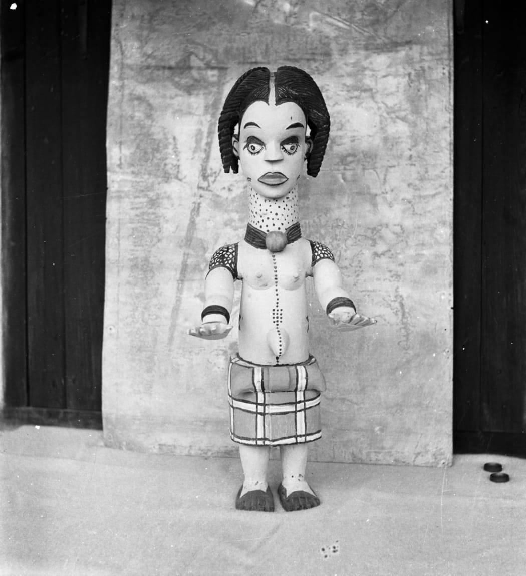 A 'modern' Anang female doll figure, carved in wood and painted in a 'naturalistic' style. Photographed by G.I. Jones in South Eastern Nigeria between 1932-1938. Image courtesy of the Cambridge Museum of Archeaology and Anthropology (N.13196.GIJ).
