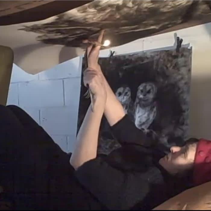 Maria Pavledis creating a drawing from smoke