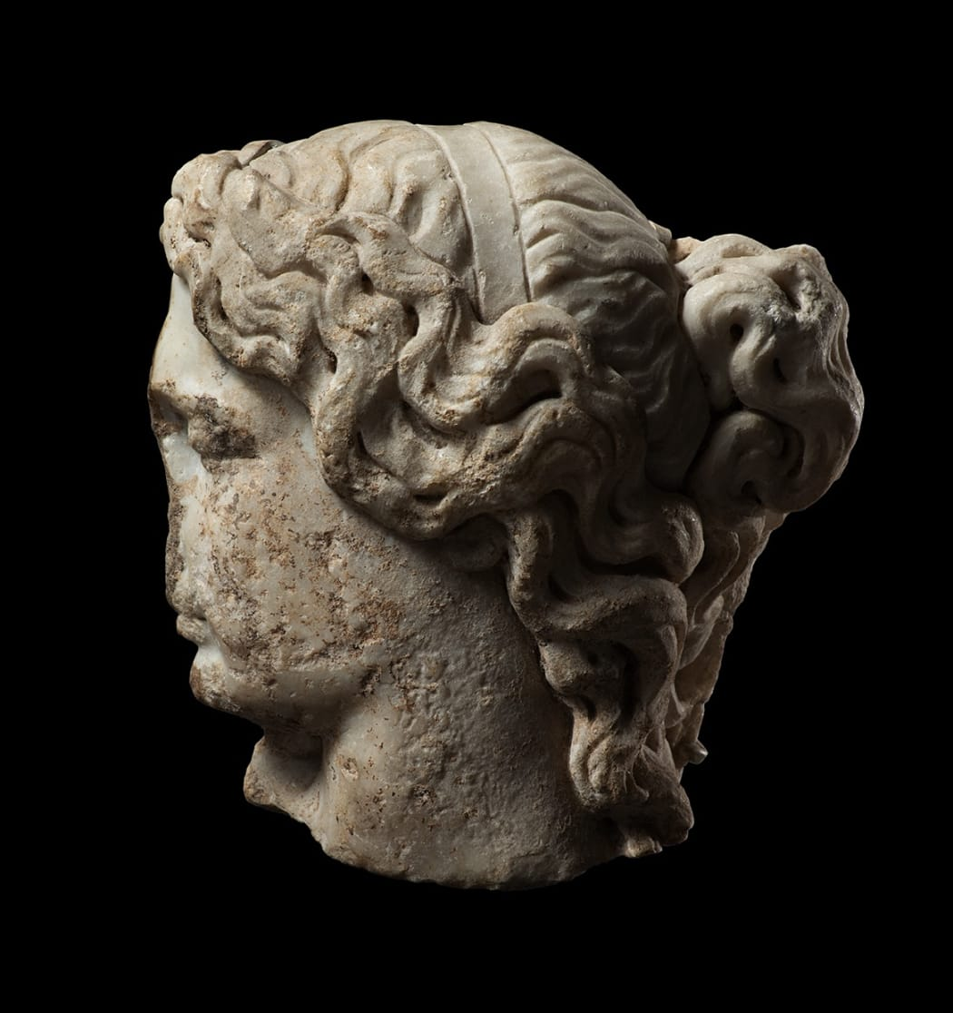 A ROMAN MARBLE FRAGMENTARY HEAD OF A SLEEPING WOMAN, Circa 2nd century AD
