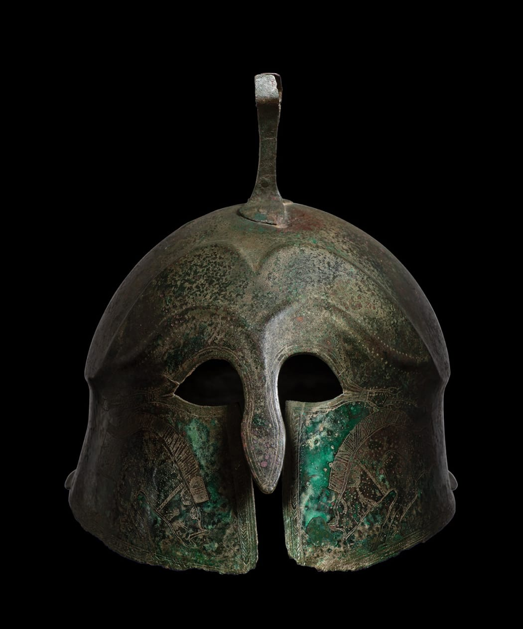 A GREEK BRONZE HELMET OF PSEUDO-CORINTHIAN TYPE, late 6th - early 5th century BC