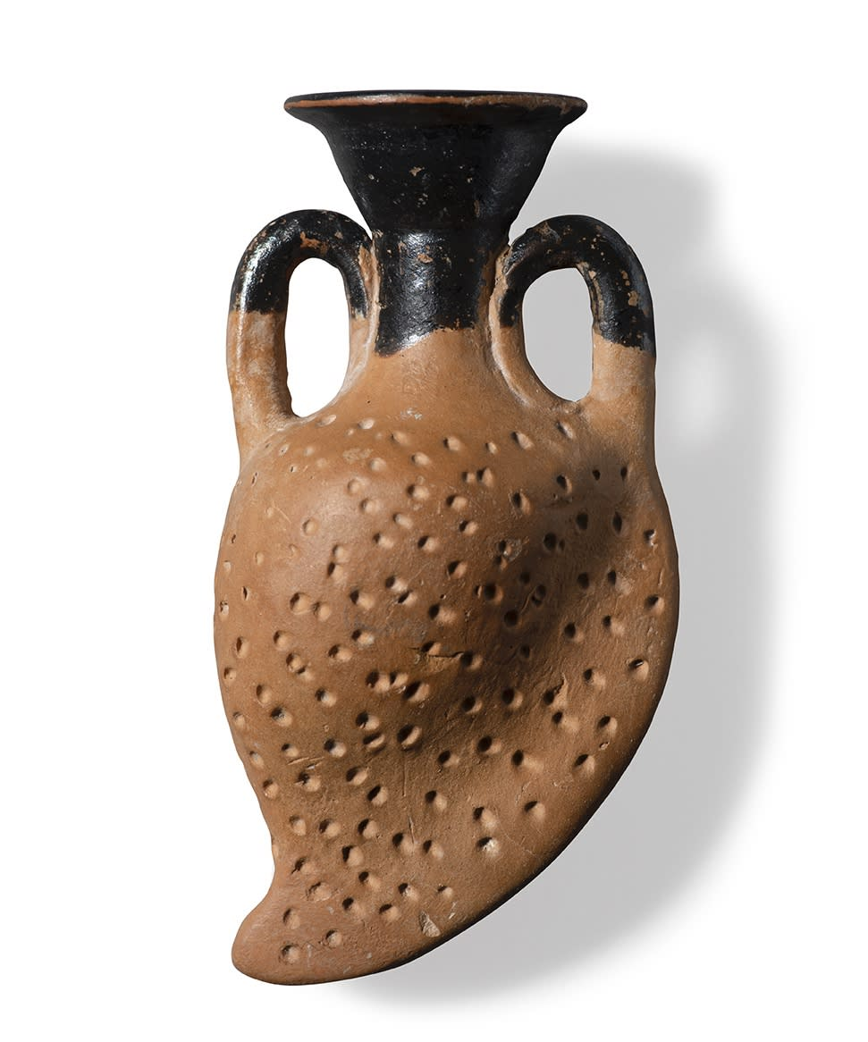 AN ATTIC POTTERY AMPHORISKOS IN THE FORM OF AN ALMOND. Circa 4th century BC