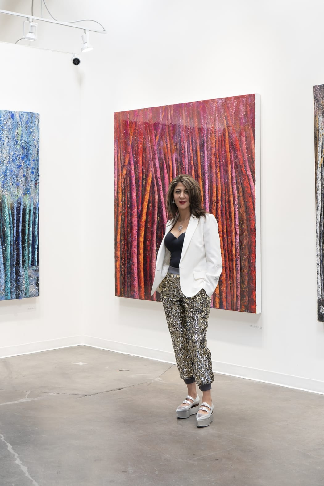 Haleh Mashian in front of her LUSTER paintings