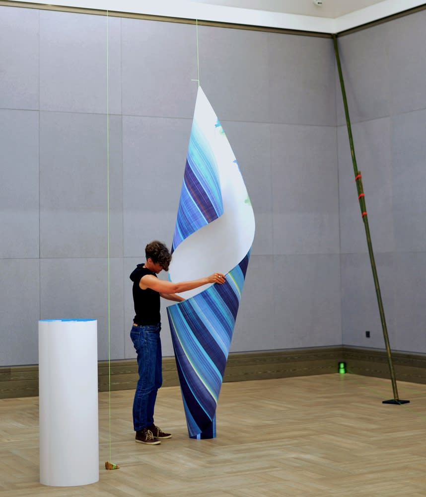 Elisabeth Sonneck installing a scrollpainting. Photo: Yang Rui