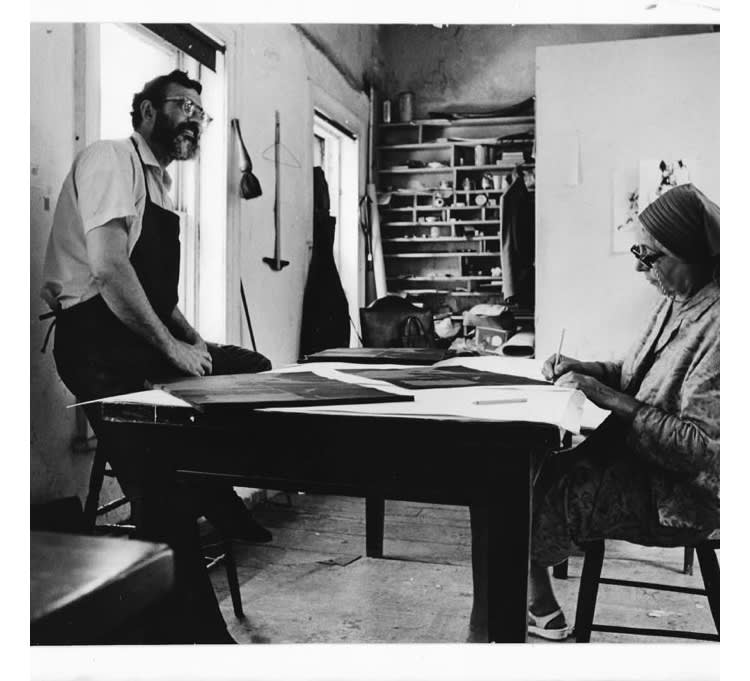 A photo of Louise Nevelson with Irwin Hollander in his studio