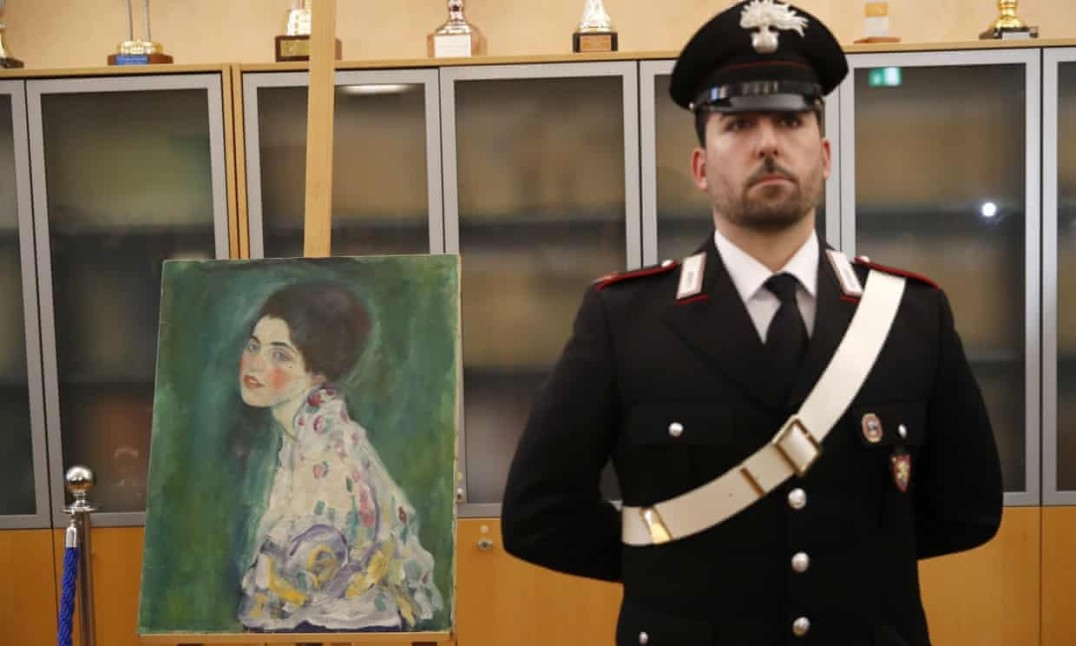 A carabiniere guards Gustav Klimt's Portrait of a Lady in Piacenza, Italy. Photograph: Antonio Calanni/AP
