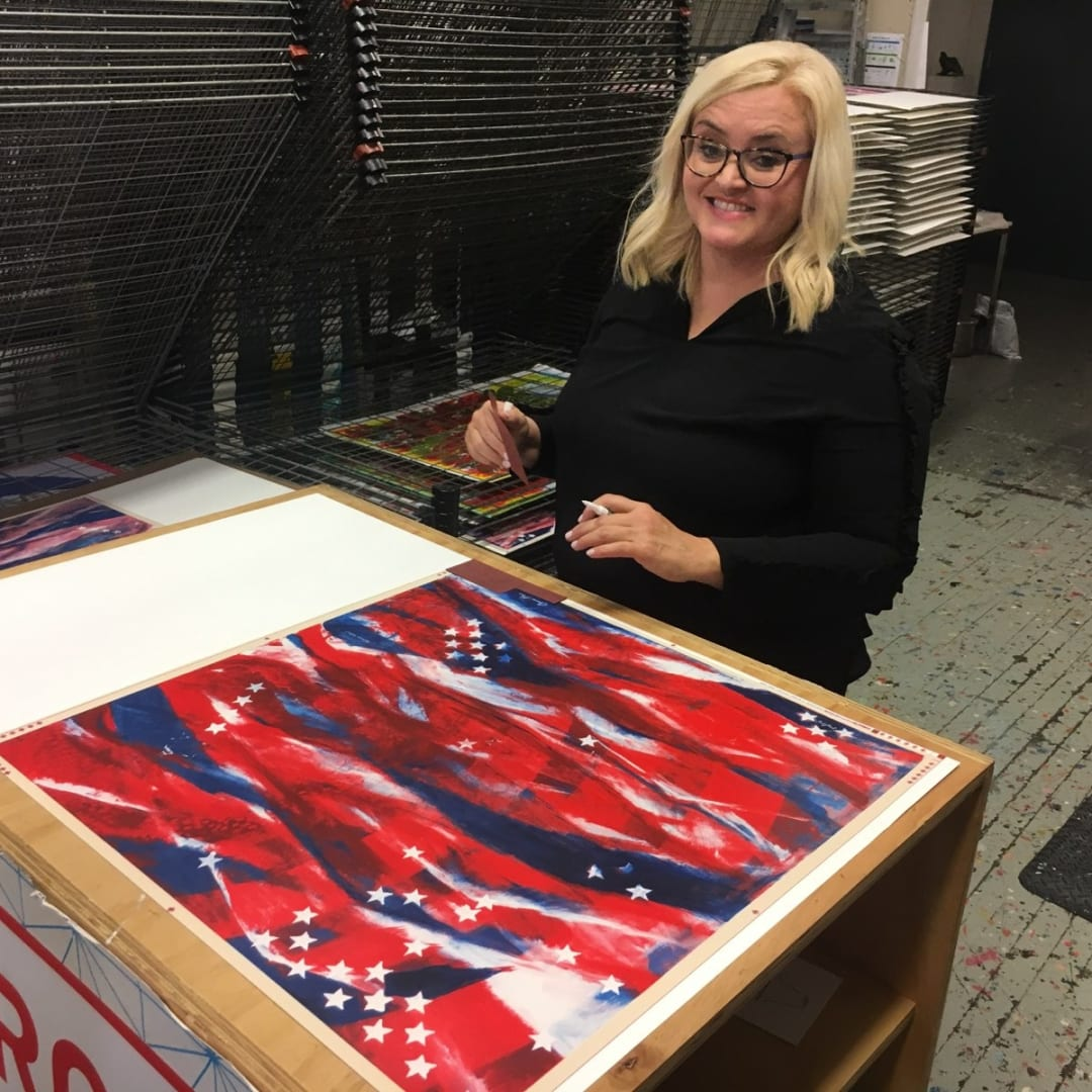 The artist smiles after signing limited edition prints of Stars and Stripes.